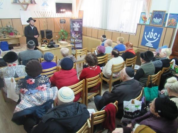Chanukah in Tiraspol - Rabbi Gotsel lighting the Menorah