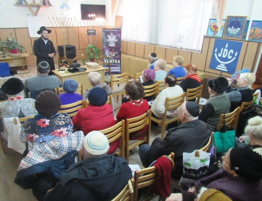 Chanukah in Tiraspol - Rabbi Gotsel lighting the Menorah